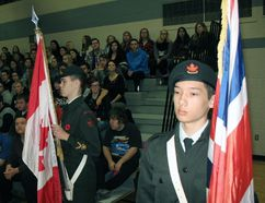 Local army cadets Luke Brennan, left, and Kaishu Tasaka served as flag bearers for Remembrance Day ceremonies at Simcoe Composite School on Friday. CHRIS THOMAS/Special to Simcoe Reformer