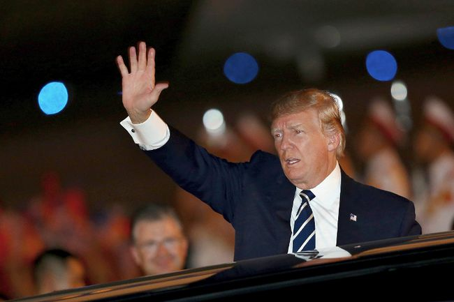 U.S. President Donald Trump waves as he arrives at the Noi Bai International Airport in Hanoi, Vietnam, on Saturday, Nov. 11, 2017. (Minh Hoang/AP Photo)