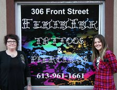 Tim Miller/The Intelligencer Body piercer Stacey Maracle (left) and tattoo artist Faye stand out front of their Front Street shop on Friday in Belleville. The pair own and operate the city's only all-female tattoo and piercing parlour.