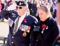 Sean Chase/Daily Observer Retired chief warrant officer Bob Howell, president of Royal Canadian Legion Branch 517, salutes while this year's Silver Cross Mother Jihan Diab reflects in silence after laying a wreath in memory of her son, Trooper Marc Diab, of the Royal Canadian Dragoons.