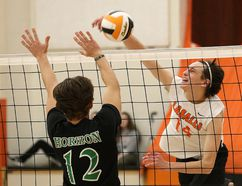 Tyrus Cuculick, right, of Lasalle Lancers, attempts to spike the ball past Jacob Lamontagne, of Horizon Aigles, during senior boys volleyball final action at Lasalle Secondary School in Sudbury, Ont. on Saturday November 11, 2017. John Lappa/Sudbury Star/Postmedia Network