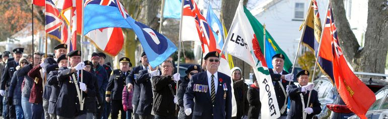 The colour party of the Royal Canadian Legion, br. 128 in Mitchell, marched north on St. Andrew Street to the Mitchell District High School (MDHS) for their annual Remembrace Day ceremony held on Saturday, Nov. 11. ANDY BADER/MITCHELL ADVOCATE