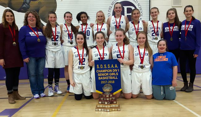 The Lo-Ellen Knights senior girls basketball team celebrates their second city title in a row on Saturday on home court. The Knights defeated Macdonald-Cartier 61-33. Keith Dempsey/For The Sudbury Star