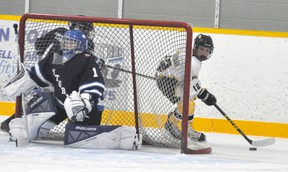 Vincent Voros (12) of the Mitchell Pee Wees peers out from behind the net for a teammate during action against Saugeen Shores from the 62nd annual Mitchell Pee Wee hockey tournament last Friday, Nov. 10. ANDY BADER/MITCHELL ADVOCATE