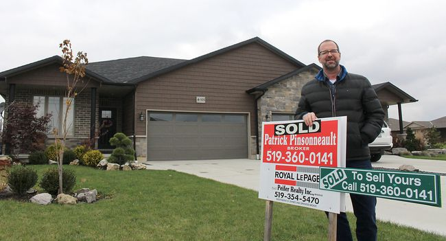 Chatham realtor Patrick Pinsonneault sees the real estate market remaining solid in Chatham-Kent, Ont. for years to come as the baby-boom generation continue to look for affordable homes in communities such as Chatham. He is pictured here on Monday November 13, 2017 with one of the many homes he has sold in recent weeks. (Ellwood Shreve/Chatham Daily News/Postmedia Network)