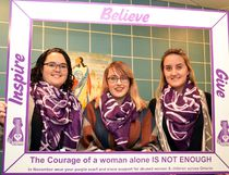 Conestoga student Ashlyn Northfield, University of Waterloo student Tori Rivard, and Optimism Place's incoming executive director, Jasmine Clark, model the purple scarves for sale locally through the 5th annual Wrapped in Courage campaign. (Galen Simmons/The Beacon Herald/Postmedia Network)