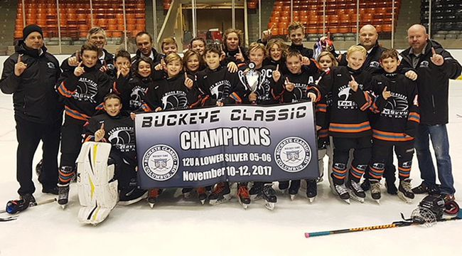 The Kent TekSavvy Peewee AE Cobras celebrate winning the Buckeye Classic in Columbus, Ohio, on Sunday, Nov. 12, 2017. The Cobras are, front row: Carson Nogueira. Middle row: Bryson Davis, Sawyer Ritchie, Kalib Stonefish, Carter McLeod, Nick Cameron, Cooper Wright, Carter Nicholson, Tanner Rush, Ryan Brophy, JP Lemak and Jack Coelho. Back row: coach Greg McMath, goalie coach Stephan Lemak, coach Brendon Dittmer, Lane Cook, Jacob Kosik, Karter Koopmans, Braiden Fieldhouse, Kohen Parker, head coach Mike Wright, and trainer Paul Brophy. Absent are Brayden Tremblay and manager Leslie Wright. (Contributed Photo)