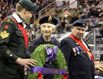 Kevin Hampson/Daily Herald-Tribune Representing Silver Cross Mothers, the Royal Canadian Legion's Frieda Wood walks up to lay a wreath, with Royal Canadian Army Cadet Sgt. Bradley Iob (left) and the Legion's Ken Buckle, during Remembrance Day ceremonies at Revolution Place on Saturday in Grande Prairie.