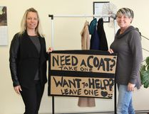 Joanne Neimi of Royal Lepage and Chantal Carriere from the Cochrane Times Post stand beside a rack of coats that available to anyone in need in the community. Neimi hopes to be able to have the community donate winter wear to those who do not have any this winter. Drop by the Cochrane Times Post office during office hours: weekdays 9 -12 noon to leave a coat, or take one if needed.