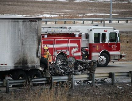 Fire and police officials on the scene of a fatal transport fire on westbound Highway 402, south of Sarnia, on Jan. 31, 2016. (BARBARA SIMPSON, Sarnia Observer)