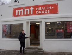 Cole Mondor, owner and pharmacy manager of Mint Health+ Drugs on Church Street, opens the door to the pharmacy on Monday, Nov. 13. Madeleine Cummings, Edmonton Examiner