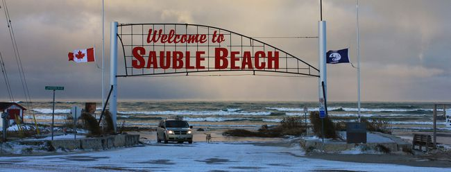 The flags flew at half-mast at Sauble Beach during a very strong north wind, with minus 19C (with the windchill) temperatures in advance of Remembrance Day, Nov. 10. Photo by Deb Ellis