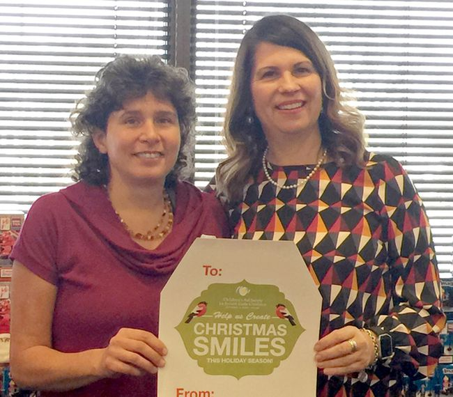 Sue Ortepi, left, manager of Creative Learning, and Gisele Hebert, executive director of the Nipissing Parry Sound Children's Aid Society, launch this year's Christmas Smiles fundraising campaign.