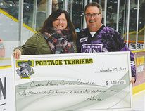 Portage Terriers president Stan Killam, right, presents CPCS executive director Sharilyn Knox with the monies raised from last month's event prior to start of play Sunday. (Heather Jordan Photography)