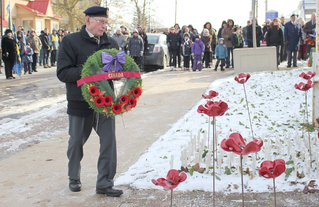 Lucknow residents came out in force in sub-zero temperatures to observe the Remembrance Day service at the cenotaph on Saturday Nov. 11, 2017. Pictured: Veteran Don Ross places the wreath of Canada at the Cenotaph during the Lucknow Remembrance Days Ceremony.  (Ryan Berry/ Kincardine News and Lucknow Sentinel)
