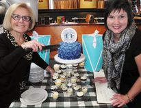 Yvonne DiPietro, left, the Simcoe & District Chamber of Commerce's long-serving general manager, called it a career Wednesday with a farewell party at The Barrel in Simcoe. At right is Meika Matthews. Matthews assumed the role of chamber president Nov. 1. MONTE SONNENBERG / SIMCOE REFORMER
