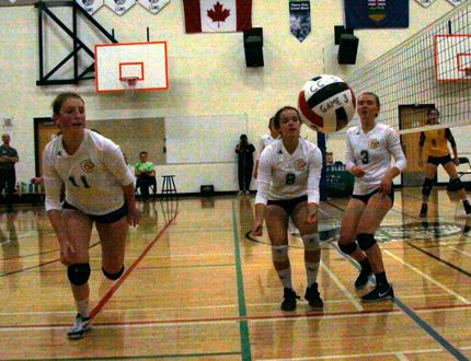 Canmore Collegiate High School players, left to right, Jenni Booth, Maya Baylis and Clara Strum vainly chase the ball during a CCHS volleyball tournament game against Olds High School on Friday, Sept. 29, 2017. (Russ Ullyot/ Bow Valley Crag & Canyon/ Postmedia Network)