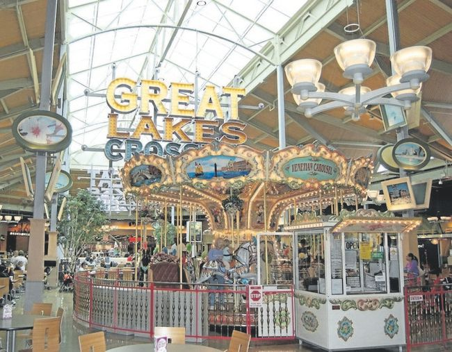 A carousel and kids' rides offer a break from shopping at the 1,000-seat food court at Great Lakes Crossing Outlets. (Jim Fox/Special to Postmedia News)