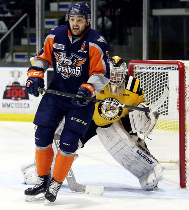 Flint Firebirds' Maurizio Colella screens Sarnia Sting goaltender Aidan Hughes at Progressive Auto Sales Arena in Sarnia, Ont., on Sunday, Oct. 29, 2017. (Mark Malone/Chatham Daily News/Postmedia Network)