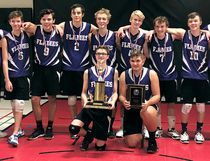The Chatham Christian Flames celebrate their victory over the Maranatha Panthers in the SWOSSAA 'A' senior boys' volleyball final in Windsor, Ont., on Wednesday, Nov. 15, 2017. The Flames are, front row, left: Nate Koomans and Dean Koomans. Back row: assistant coach Dale Lahey, Braden Hoogstad,  Jakob Taylor, Daniel Burggraaf, Nate Dam, Daniel Wall, Will DeKoter, Kaleb Reimer and head coach Richard Koomans. Derek Bos is absent. (Contributed Photo)
