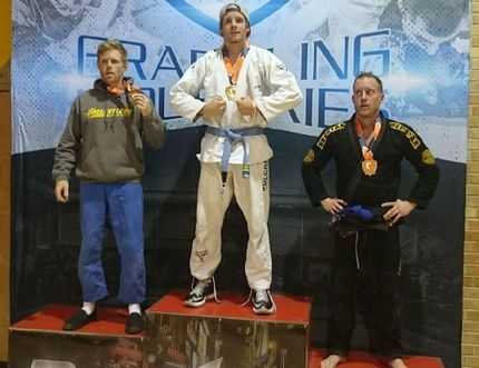 Huron BJJ head instructor and Blue Belt, Shaun Gregory, poses with the gold medal he earned at the Nov. 4 Brazilian Jiu-Jitsu tournament. Two of Gregory's Huron BJJ students from the Clinton area, both White Belts, claimed silvers in their divisions. (PHOTO COURTESY OF SHAUN GREGORY)