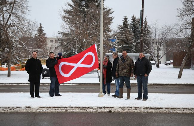 Jeffery O'Donnell CEO of the CRDAC, Ron Quintal president of the McKay Métis, Gail Gallupe president of McMurray Métis, councillor Mike Allen, Darrin Bourque vice president of Willow Lake Métis Local 280 and Bill Loutitt vice president of McMurray Métis, ceremoniously raise the Métis flag downtown Fort McMurray on the 132nd anniversary of Louis Riel's death, November 16, 2017. Olivia Condon/ Fort McMurray Today/ Postmedia Network