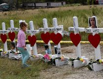 Shaelyn Gisler, 4, prepares to leave flowers on crosses named for the victims outside the First Baptist Church, which was the scene of a mass shooting that killed 26 people in Sutherland Springs, Texas, on Nov. 9. (Mark Ralston/Getty Images)