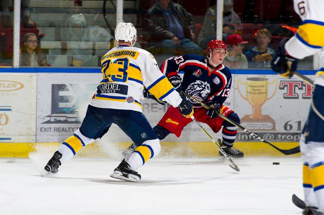 Tim Theocharidis defends against Cornwall's Tommy Tanner during CCHL contest in Cornwall on Thursday. Robert Lefebvre/Special to the Cornwall Standard-Freeholder