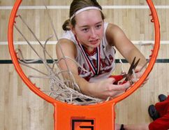 St. Marys DCVI player Laura Vink helps cut down the mesh from the basket after the Salukis defeated North Middlesex 49-36 in the WOSSAA senior girls single-A championship Thursday night in Woodsock. (Cory Smith/The Beacon Herald)