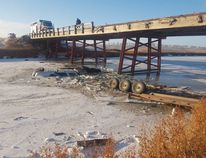 A St. Claude man's truck ended up submerged in icy water after the driver lost control and slid off a bridge in the RM of Dufferin Friday morning. (COURTESY RCMP)