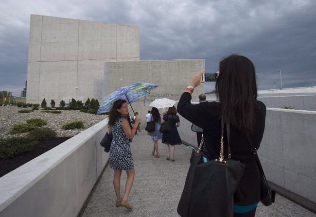 A woman stops to take a photo of the Canadian National Holocaust Monument following its official opening ceremony in Ottawa, Wednesday September 27, 2017. THE CANADIAN PRESS/Adrian Wyld
