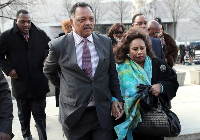 Rev. Jesse Jackson (L) and his wife Jacqueline Lavinia Brown (R) arrive at U.S. District Court for a hearing involving his son, former Rep. Jesse Jackson Jr., February 20, 2013 in Washington, DC. (Photo by Win McNamee/Getty Images)