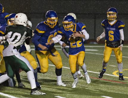 BCI Mustangs quarterback Josh Downy (6) watches Jordan Wilhelm (22) rush for yardage during a CWOSSA senior football semifinal game against Guelph Collegiate on Wednesday. BCI won to advance to the final against Cambridge's Jacob Hespeler Secondary School on Tuesday night in Waterloo. (Brian Thompson/The Expositor)