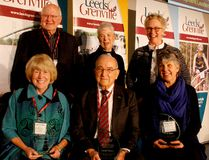 Heather Howard, bottom left, Gerald Tallman and Wendy Banks, the three co-winners of this year's Bill Thake Award, pose after receiving the honour at Friday's Leeds and Grenville Economic Development Summit. Standing behind them, from left, are Glenn Allen, the award's first recipient, Thake's widow, Marlene, and United Counties Warden Robin Jones. (RONALD ZAJAC/The Recorder and Times)