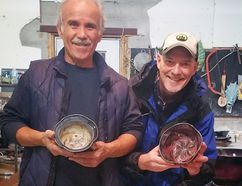 Renton potter Joe Panacci and Gregg McLachlan of WorkCabin Creative hold a pair of the bowls available for sale as part of the Empty Bowls Fundraiser in conjunction with next week's Holiday Soup Luncheon. The annual luncheon will feature a number of area restaurants with proceeds going to local food banks. (Contributed Photo)