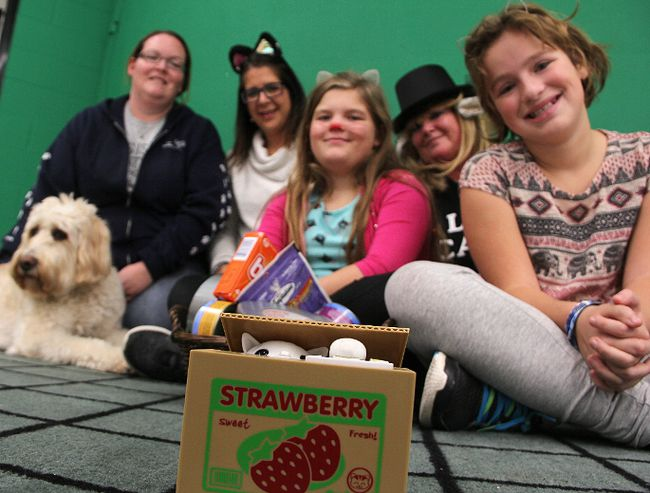 "Nicole King with the Sarnia and District Humane Society, left; King George VI principal Tracy Pereira; staff member Jan Moran; and Grade 5 students Luella Smith, front left, and Ella Griffin-Turner, pose behind a coin box featuring a mechanical cat. It's been the drop box for a coin drive at the Sarnia school, raising money for the humane society. There's a theme. The school is trying to help cats ""wait less"" for care, while welcoming ""Weightless"" rockers See Spot Run to the school for a concert March 29. That event also features a video message from school alumnus and astronaut Chris Hadfield about weightlessness. Also pictured is labradoodle-wheaten-mix Charlie, 5.  Tyler Kula/Sarnia Observer/Postmedia Network"