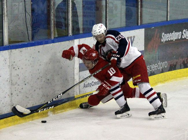 Stephen Uhler/Pembroke Daily Observer/Postmedia NetworkPembroke Lumber King Jared Weber (10) gets in difficulties with Cornwall Colt Sam Lau (25) during Sunday's CCHL game at the Pembroke Memorial Centre. The Kings were beaten 4-0 by the visitors.