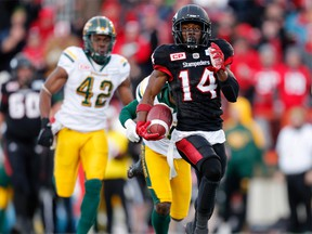The Calgary Stampeders' Roy Finch runs by Edmonton Eskimos to score a touchdown during CFL Western Final action at McMahon Stadium in Calgary, Alta.. on Sunday Nov. 19, 2017. (Leah Hennel/Postmedia)