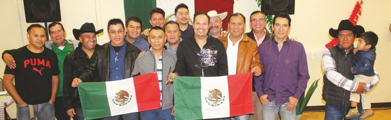 PHOTO COURTESY OF KELCI NICODEMUS. A large group of High River's Mexican Cargill staff members, many of whom first arrived in the community a decade ago this year, gathered at the Masonic Hall in mid September to celebrate their being in town for 10 years and living with their families in Canada.