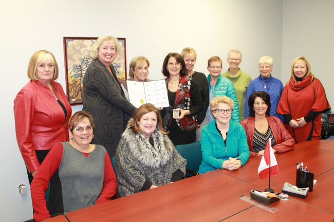 Representatives from 100 Women Who Care Sarnia-Lambton picked up their Sesquicentennial Award pins at a ceremony at Sarnia-Lambton MP Marilyn Gladu's constituency office Nov. 15.