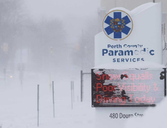 The conditions that caused snow squalls and poor visibility on local roads nearly obscured the Perth County Paramedic Services sign warning of those very conditions in this December 2016 file photo. Southwestern Ontario is in store for above average snowfall this winter, according to The Weather Network. Postmedia Network File Photo