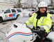 """Luke Hendry/The Intelligencer Belleville Police Const. Brad Stitt sits astride a police motorcycle outside headquarters Monday in Belleville. """"Any time we have different classes of vehicles on the road — everybody's got to work cooperatively,"""" he said. You have to make that eye contact. You have to give enough room and share the roadway."""""""
