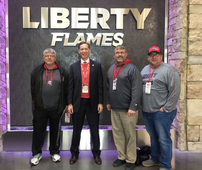 <p>From left, at the home of the Liberty Flames NCAA football team in Lynchburg, Va., are Rob McDonald, Liberty University athletic director Ian McCaw, David McDonald and Troy Hickman.</p><p> Handout/Cornwall Standard-Freeholder/Postmedia Network