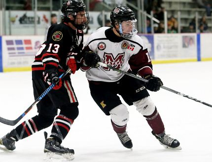 Chatham Maroons' Josh Supryka, right, battles Sarnia Legionnaires' Ethan Dupont in the third period at Chatham Memorial Arena on Sunday, Nov. 19, 2017. (Mark Malone/Chatham Daily News/Postmedia Network)
