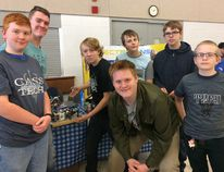 CASS tech students show off their Sorty Bot Tuesday at the Oxford Invitational Youth Robotics Challenge Tuesday. From left Connor Hughes, Dylan Hewitt, Jacob Payne, Tim Jones, Michael Wright, Jared Spring and Jason Waterland. (HEATHER RIVERS, Sentinel-Review)