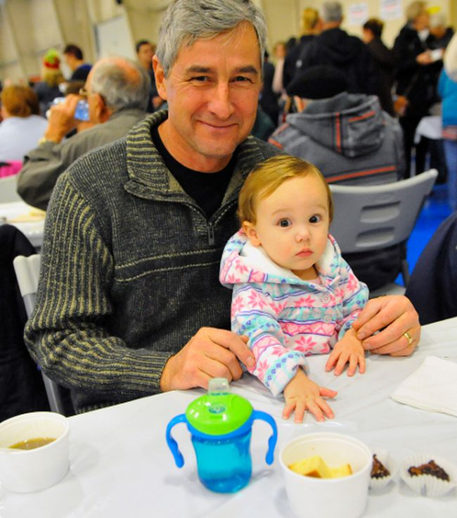 Carl Atkinson and grandaughter Callie, 2, of Simcoe were among the 1,000 people who attended Tuesday's Holiday Soup Luncheon fundraiser. JACOB ROBINSON/Simcoe Reformer