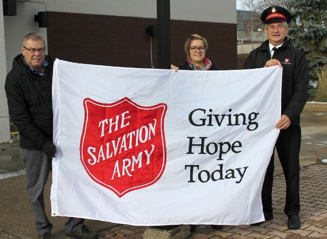 <p>The Salvation Army's Kettle Campaign kicked off with the flag raising on Tuesday November 21, 2017 in Cornwall, Ont. Mayor Leslie O'Shaughnessy helps Julie Leroux and Rev. Oren Cole with the flag.</p><p>
