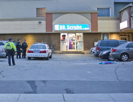 Police investigate a fatal hit-and-run in a plaza parking lot at 1221 Dundas St. in London, Ont. on Tuesday, November 21, 2017. (DEREK RUTTAN, The London Free Press)