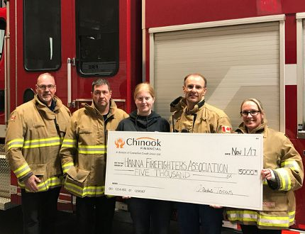Top photo, accepting the donation from Chinook Financial are, left to right: Adrian Mohl (firefighter), Brent Olesen (deputy chief), Michele Toews (Chinook Financial), Glen Durand (lieutenant) and Jill Olesen (firefighter). (Photo courtesy of Chinook Financial)