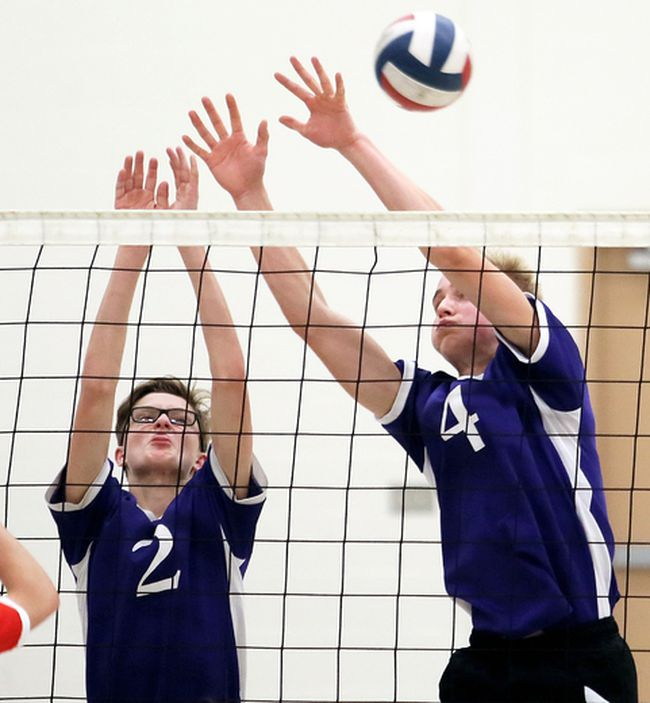 Chatham Christian Flames' Nate Koomans (2) and Nate Dam (4) try to block Maranatha Panthers' Luke Brouwer (8) during the second set in the SWOSSAA 'A' senior boys volleyball final at Chatham Christian High School in Chatham, Ont., on Tuesday, Nov. 15, 2016. (Mark Malone/Chatham Daily News)